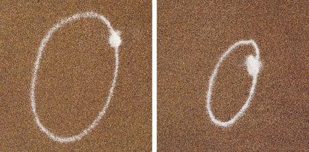 O - white alphabet written in brown sand  Stock Photo - 4988139