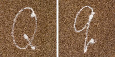 Q - white alphabet written in brown sand  Stock Photo - 4988136