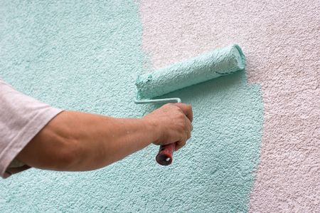 painting wall with a roll in green outdoor Stock Photo - 5208304
