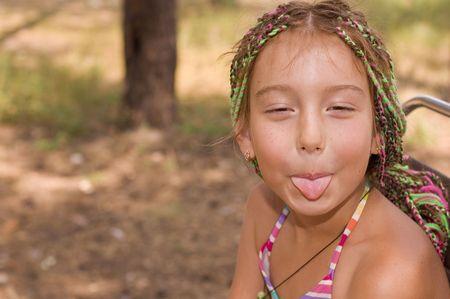 cute funny liitle girl show tongue photo