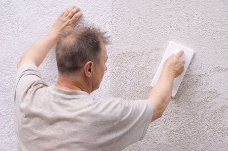 man makes renovation photo