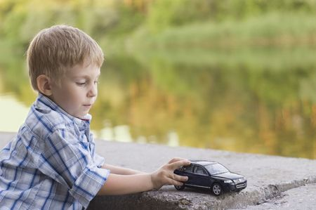 little boy play with a car outdoor Stock Photo - 5312748