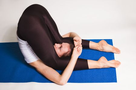 young attractive yoga girl doing yogatic exericise photo