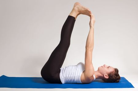 young attractive yoga girl doing yogatic exericise photo