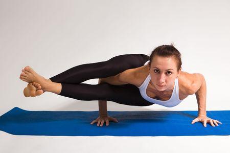 young attractive yoga girl doing yogatic exericise Stock Photo - 5928796