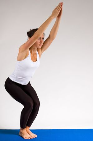 young attractive yoga girl doing exercise photo