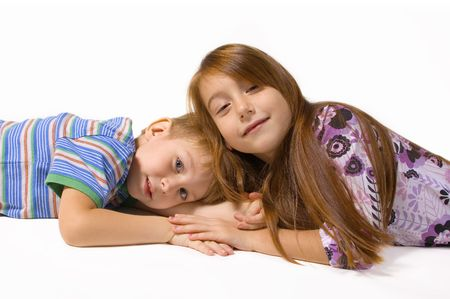 two happy children isolated on white background photo