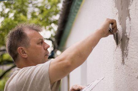 craftwork: man makes renovation outdoor