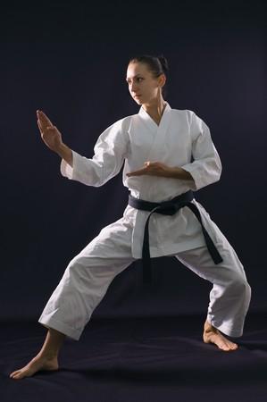 karateka girl on black background studio shot photo