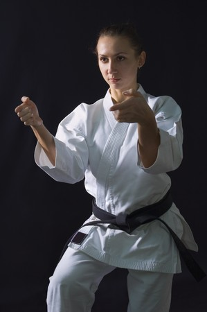 karateka girl on black background studio shot Stock Photo - 7017850