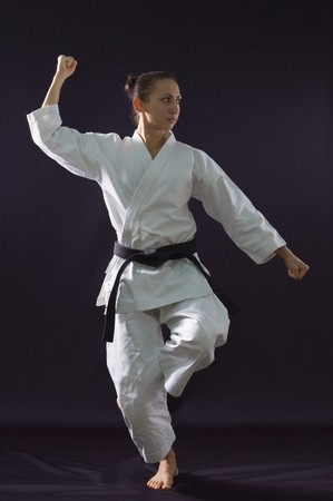 karateka girl on black background studio shot Stock Photo - 7017851