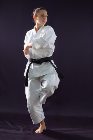 karateka girl on black background studio shot photo