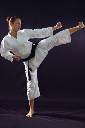 taekwondo: karateka girl on black background studio shot