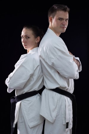 karateka couple on black background studio shot Stock Photo - 7017926