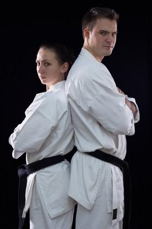karateka couple on black background studio shot Stock Photo - 7017926