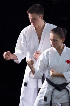 karateka couple on black background studio shot photo
