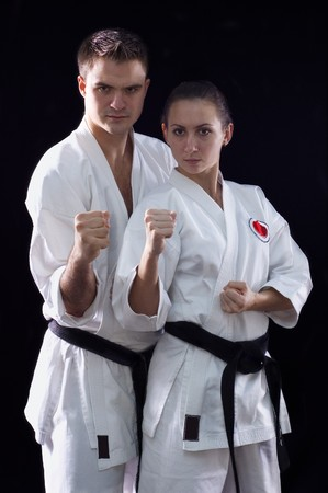 karateka couple on black background studio shot Stock Photo - 7017934