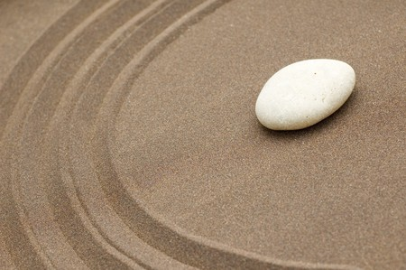 zen garden of sand and stone with copyspace photo
