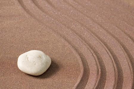 zen garden of sand and stones with copyspace photo