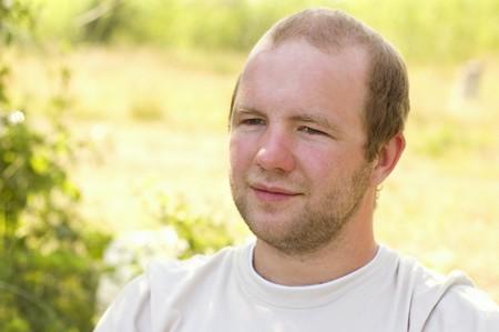 vertica: portrait of young man summer outdoor