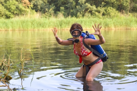 funny scuba diver young woman summer river  photo