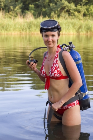 scuba diver young woman summer river  photo