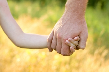 father lead by the hand son outdoor Stock Photo - 7475205