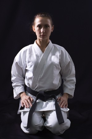 martial arts: karate girl on black background studio shot Stock Photo