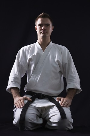 karateka: karate man on black background studio shot Stock Photo