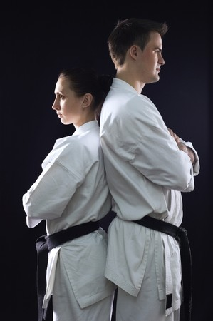 karate couple champions of the world in profile on black background photo