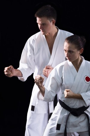 karateka couple on black background studio shot Stock Photo - 7502261