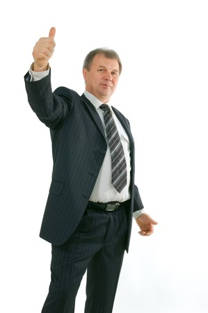 mature busnessman with thumbs up isolated on white background photo