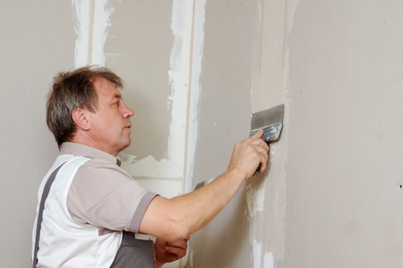 man putty plasterboard indoor Stock Photo - 7733833