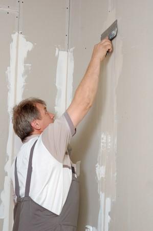 man putty plasterboard indoor photo