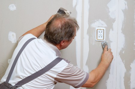 plasterboard: man putty plasterboard indoor