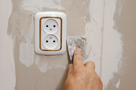 putty near wall outlet - renovation indoor Stock Photo - 7733850