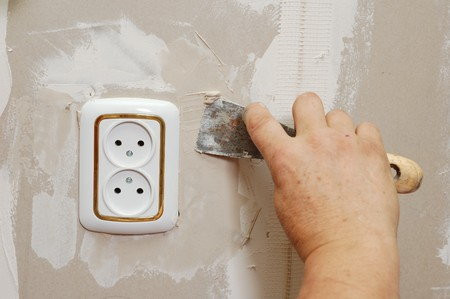 putty near wall outlet - renovation indoor photo