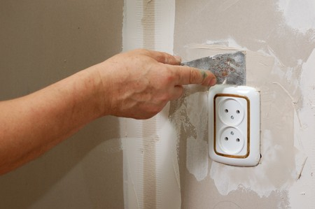 renovation indoor - putty near wall outlet photo