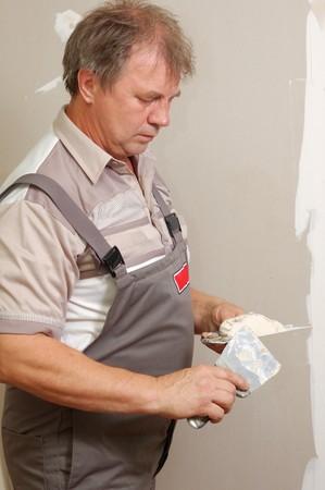 renovation - man with towels indoor photo