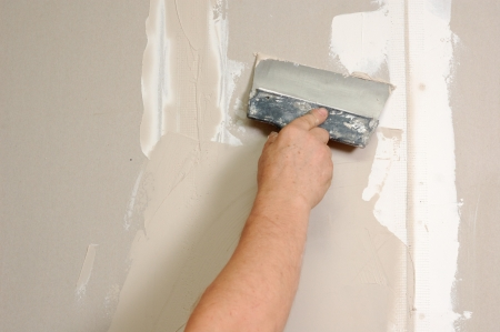 caulk: home improvement - man stop up indoor