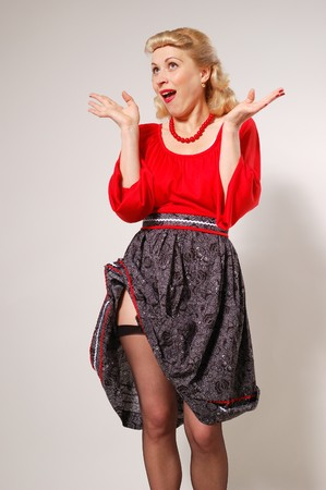 stylization of happy pin-up girl with dress up studio shot photo