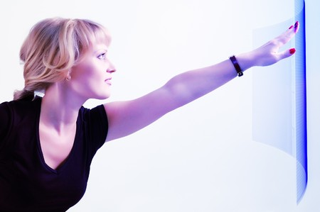 woman beautiful touch screen over light blue background photo