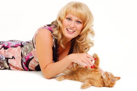 beautiful woman playing with kitten isolated on white background photo