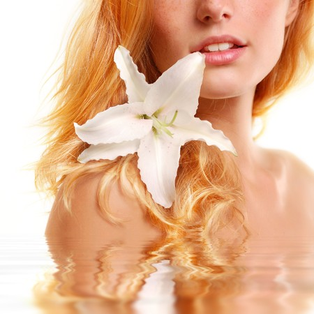 beautiful young woman with flower isolated on white background Stock Photo - 8131878