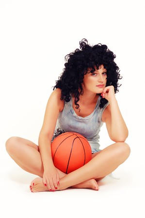 beautiful woman with basketball ball isolated on white background photo