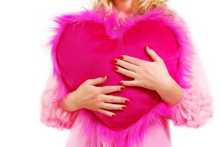 woman holding heart isolated white background photo