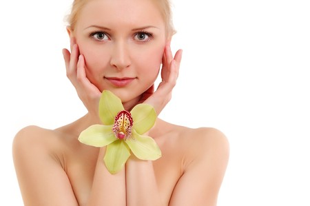 beautiful young woman with orchid isolated on white background photo