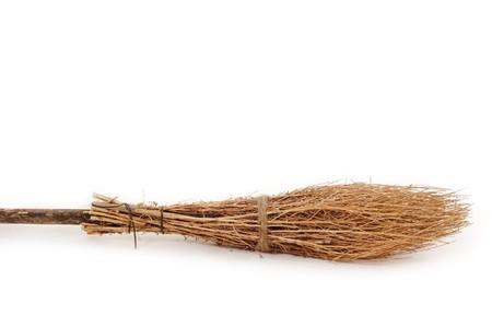 witchery: broom wooden brushwood isolated on white background
