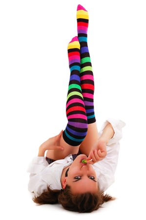 girl in striped motley knee-length socks sucks lollipop isolated on white background Stock Photo - 8131817