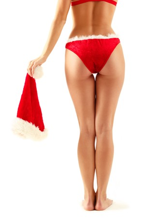 long legs christmas girl with hat in hand isolated on white background Stock Photo